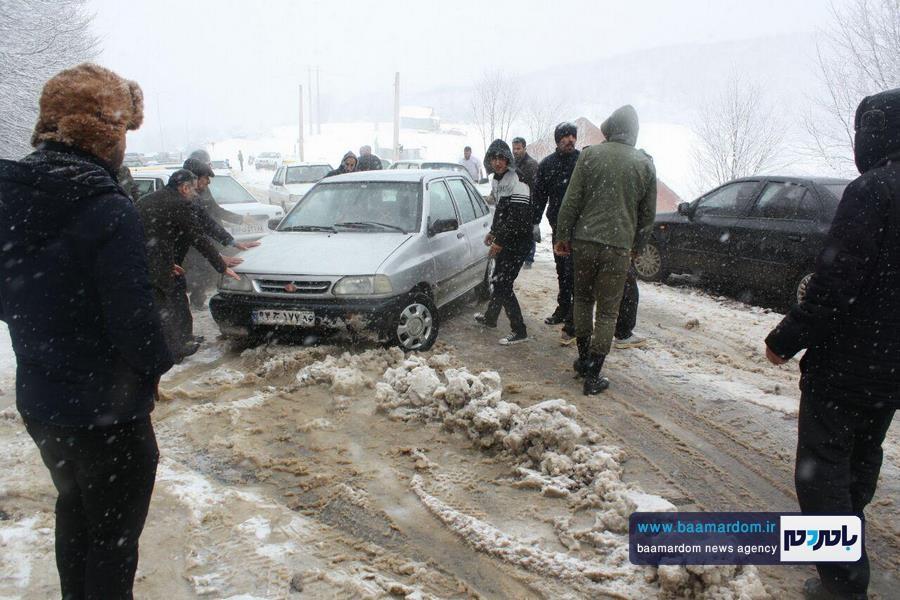 برف بهاری دیلمان 11 - بارش برف بهاری و ترافیک طولانی در جاده سیاهکل به دیلمان   مسافران هشدارهای پلیس راهور را جدی بگیرند