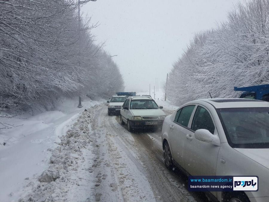 برف بهاری دیلمان 2 - بارش برف بهاری و ترافیک طولانی در جاده سیاهکل به دیلمان   مسافران هشدارهای پلیس راهور را جدی بگیرند